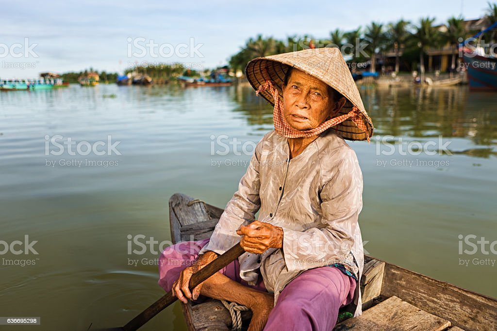 Vietnamese woman in a boat,  Hoi An stock photo