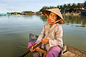 Vietnamese woman in a boat,  Hoi An