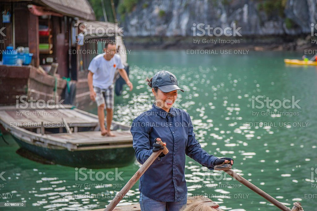 Vietnamese woman in a tourist boat in Halong Bay, Vietnam stock photo