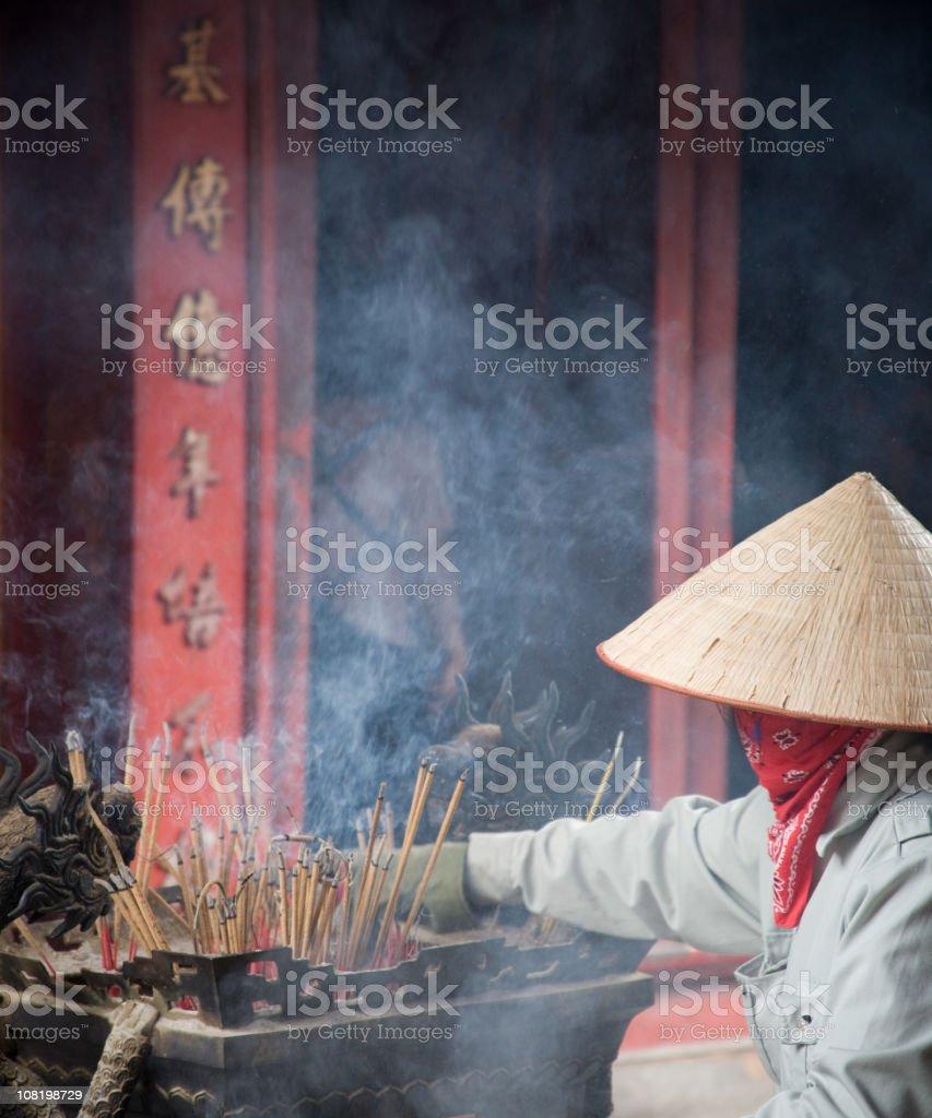 Vietnamese Woman Lighting Incense stock photo
