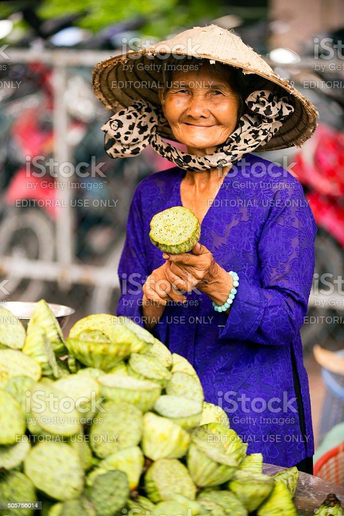 Vietnamese Woman Lotus Pod stock photo