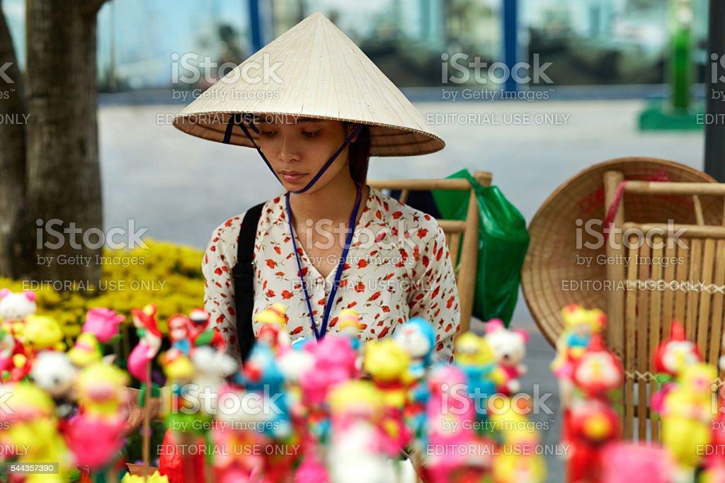 VIETNAM, HO CHI MINH - Vietnamese Woman Merchant Selling Souveni stock photo