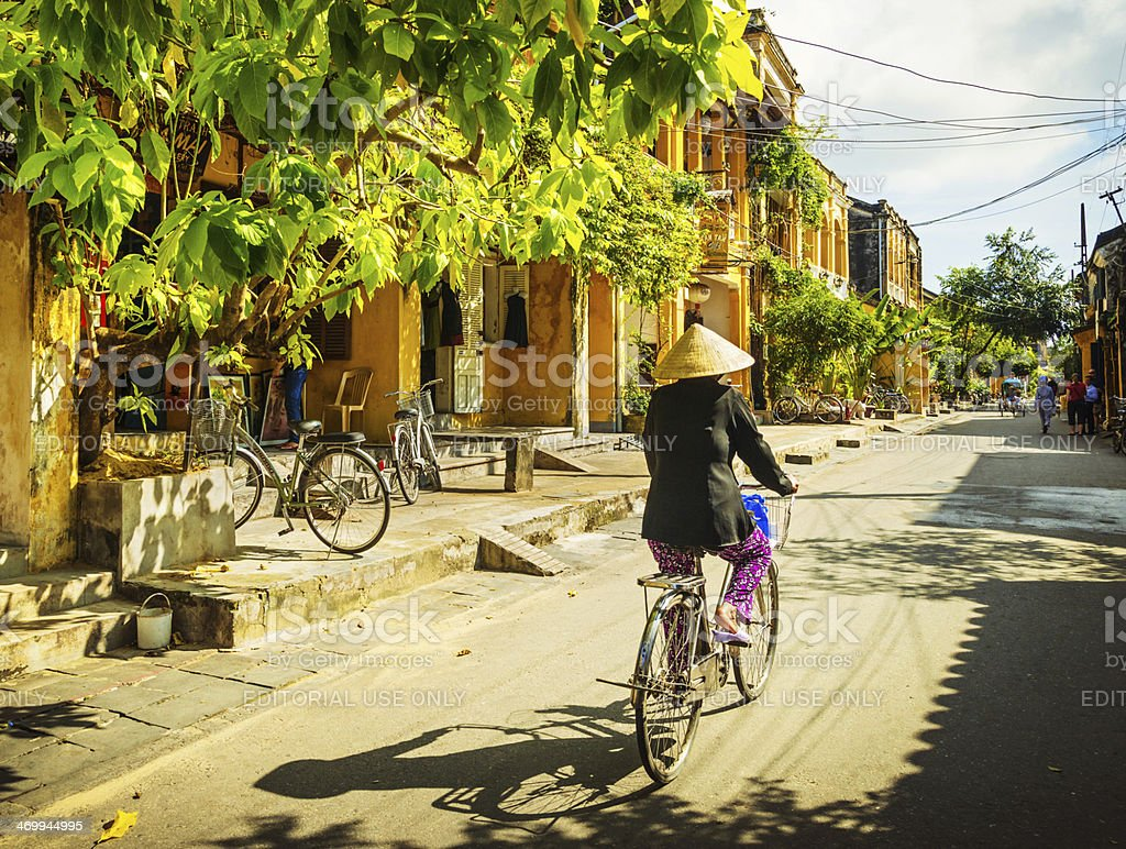 Vietnamese woman on a bicycle stock photo