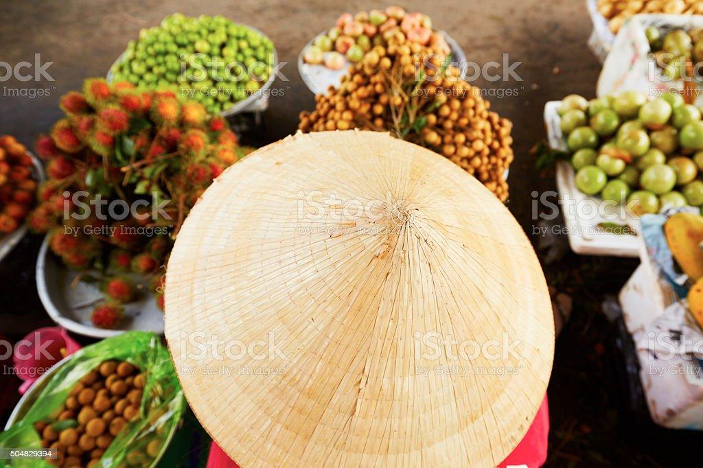 Vietnamese woman on the street market stock photo