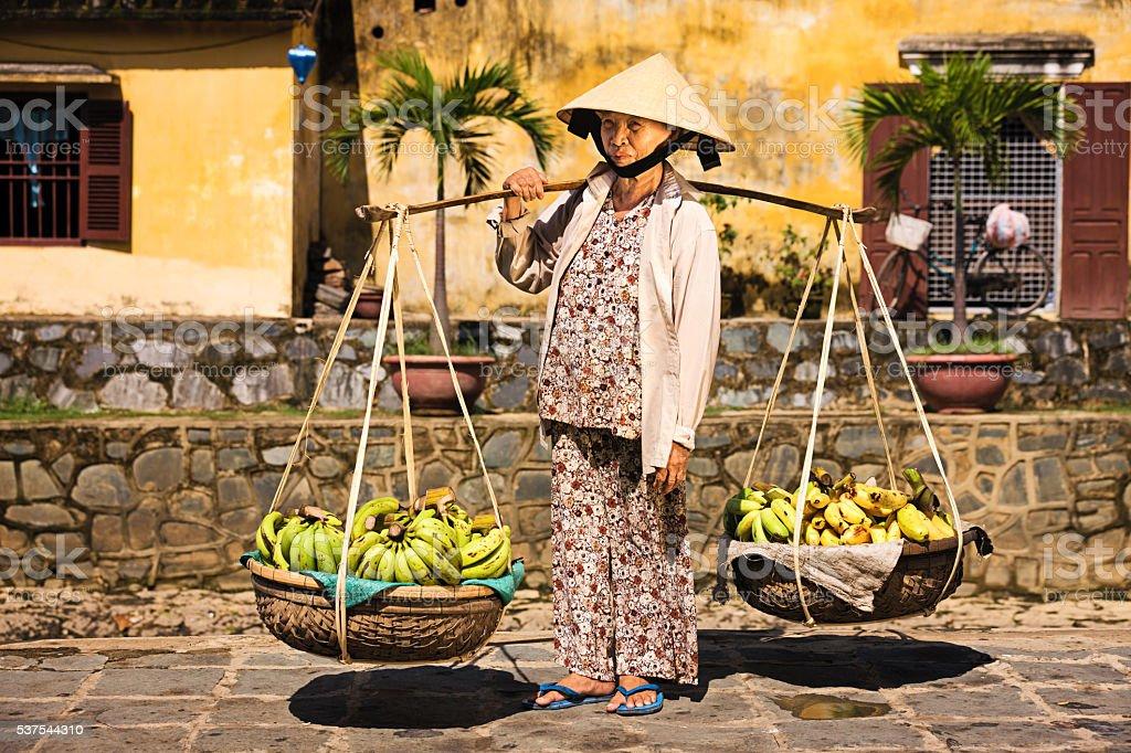 Vietnamese woman selling bananas in Hoi An stock photo