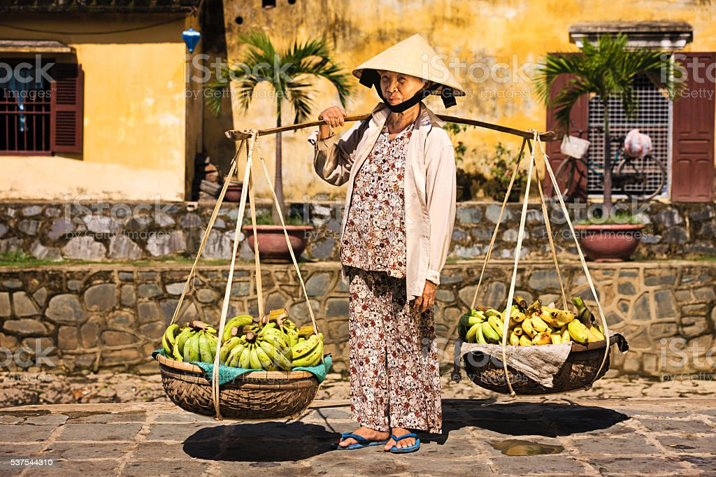Vietnamese woman selling bananas in Hoi An stock photo