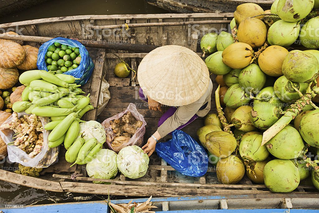 Vietnamese woman selling fruit on floating market Mekong River Delta royalty-free stock photo