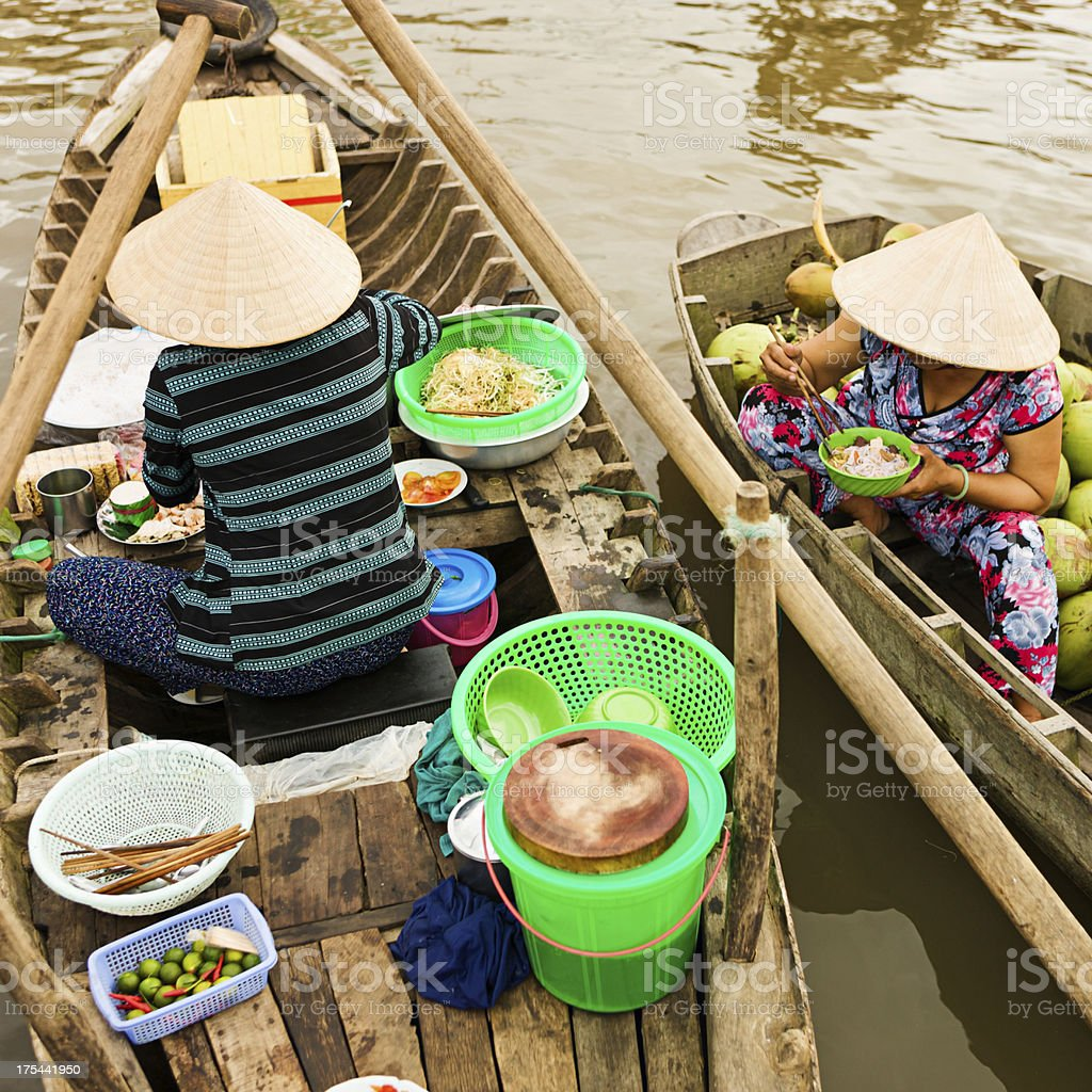 \'Vietnamese Pho seller on floating market - woman selling noodle soup...