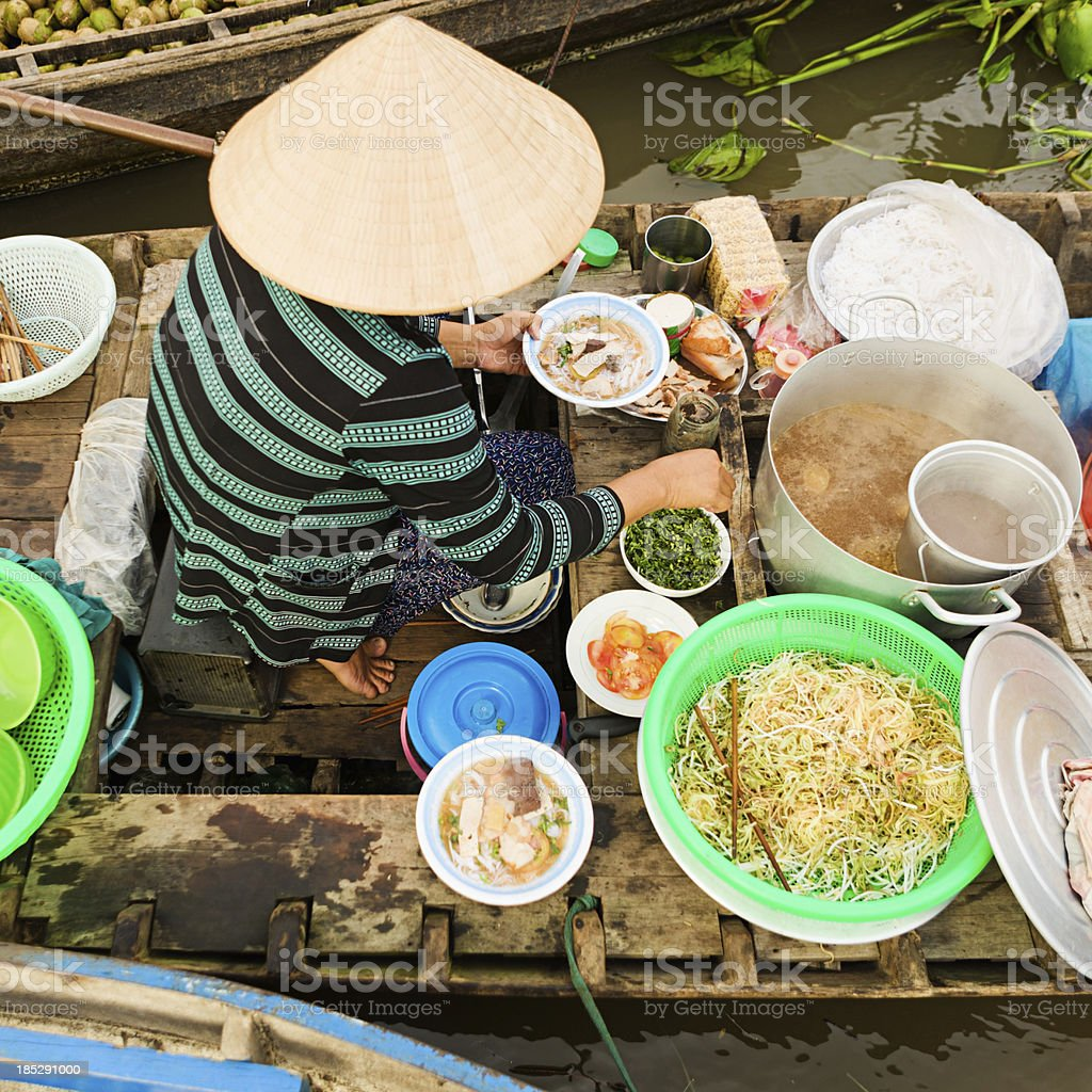 Vietnamese woman selling  Pho - noodle soup on floating market stock photo
