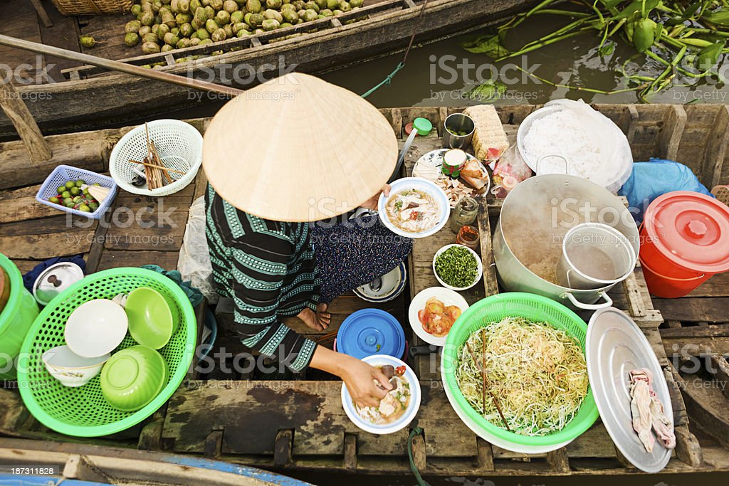 Vietnamese woman selling  Pho - noodle soup on floating market royalty-free stock photo