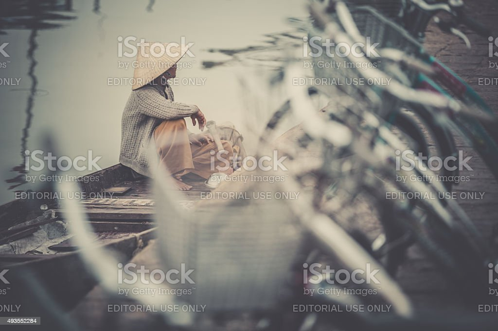 Vietnamese Woman Wearing Traditional Hat on Boat stock photo
