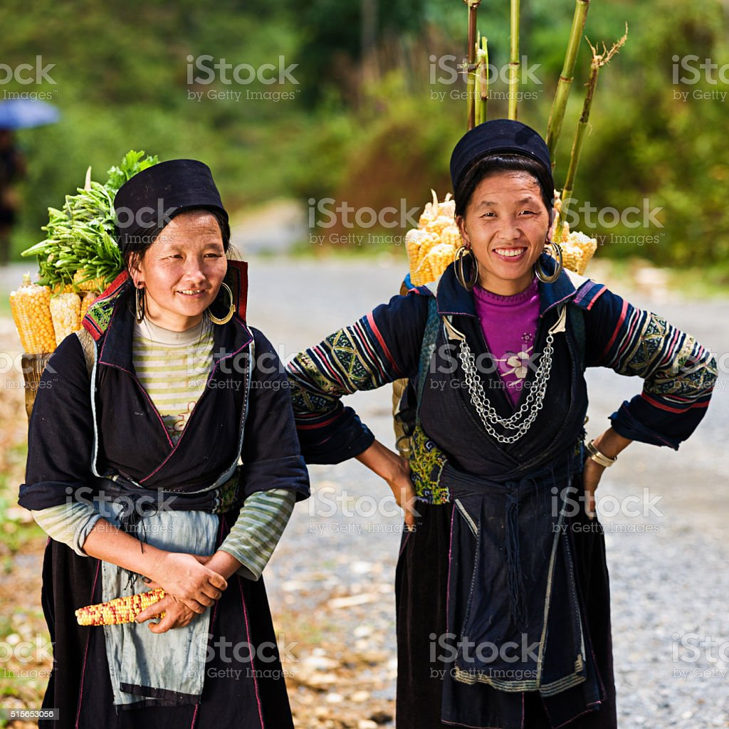 Vietnamese women carrying corn near Sapa town stock photo