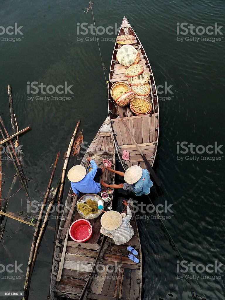 Vietnamese women having a lunchbreak in their boats. Hoi An stock photo