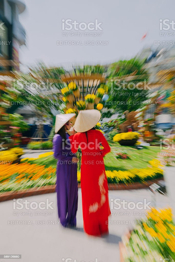 Vietnamese women in traditional Ao Dai dress stock photo