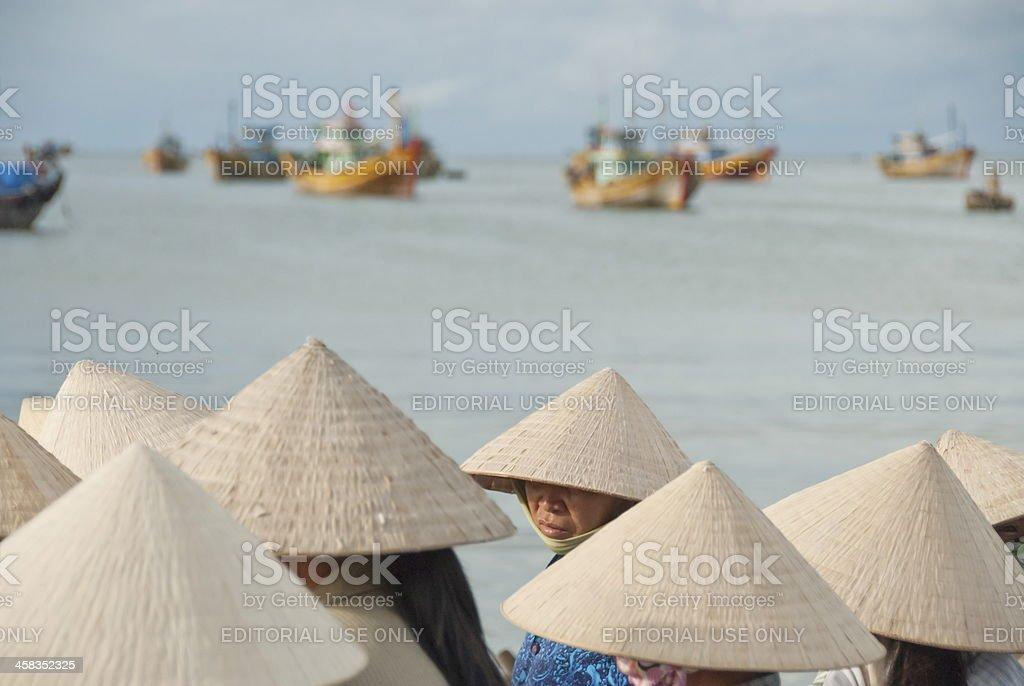 Vietnamese women in traditional conical hats, Mui Ne, Vietnam. royalty-free stock photo