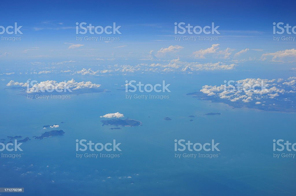 View above the earth and clouds below stock photo