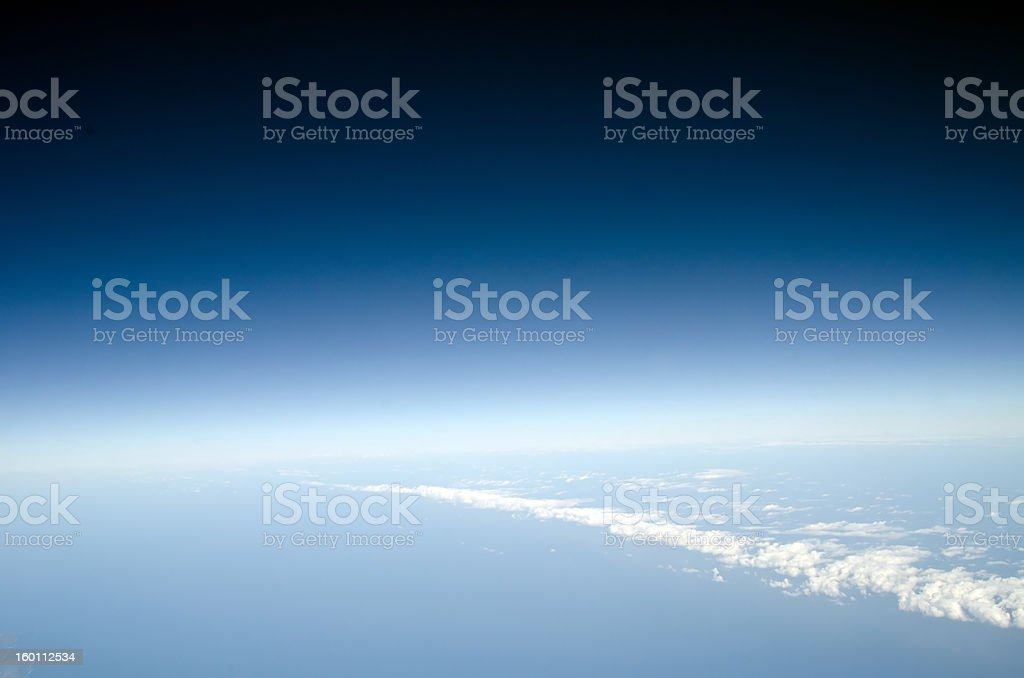 View above the earth at clouds below royalty-free stock photo