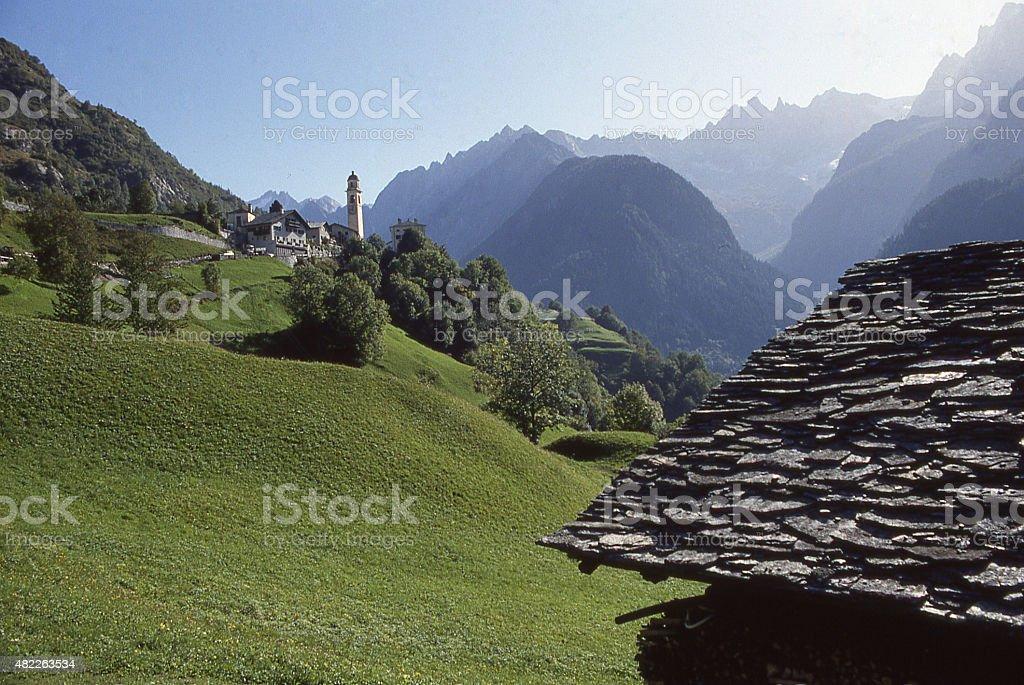 View across alpine pastures Italian Swiss Alp village Soglio Switzerland stock photo