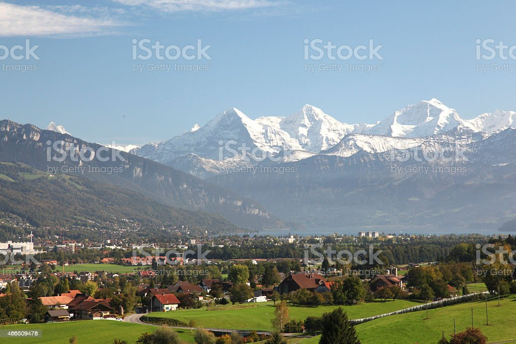 View across fields to Swiss Alps and Interlaken stock photo