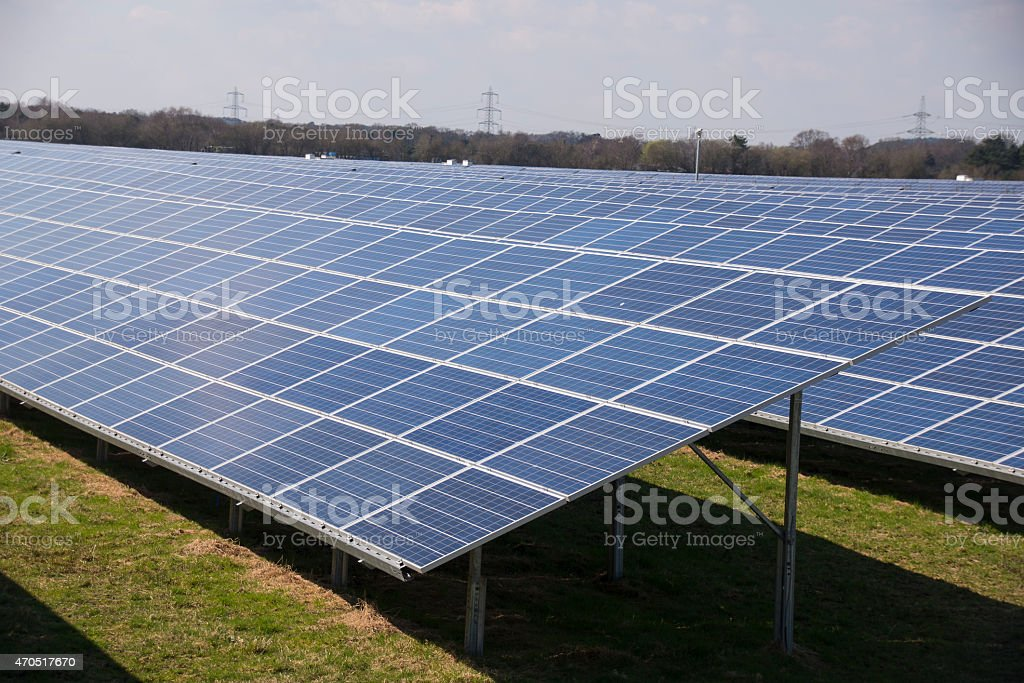 View across large solar panels in a solar farm royalty-free stock photo