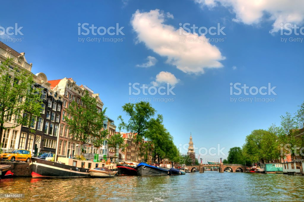 View along Singel canal in Amsterdam to Munttoren tower royalty-free stock photo