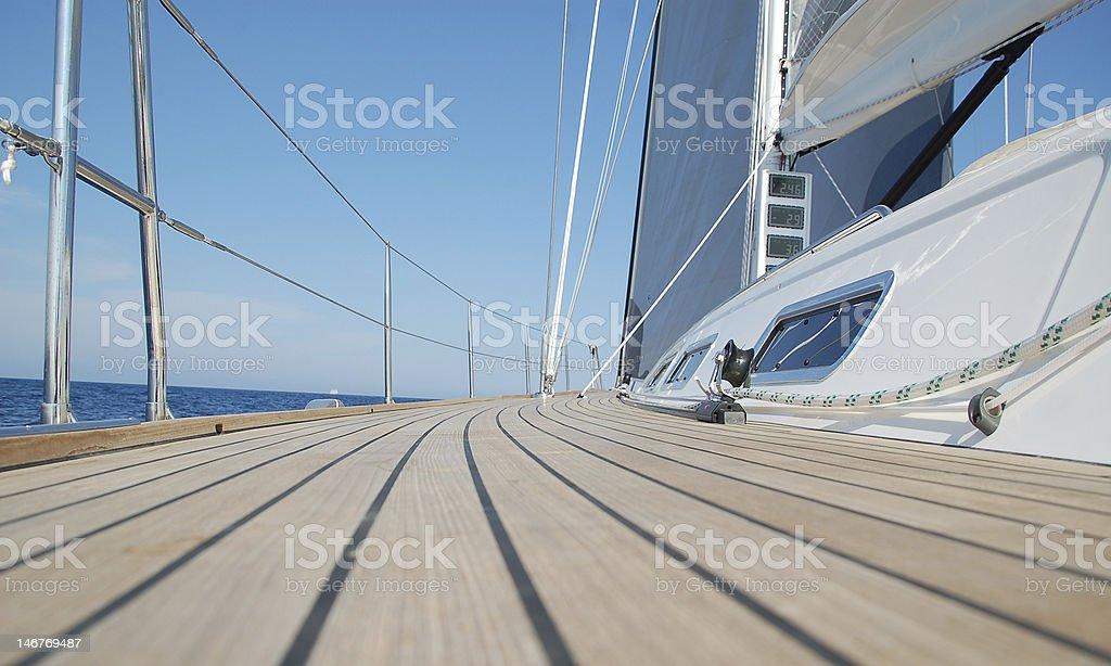 View along teak deck on a sailboat stock photo