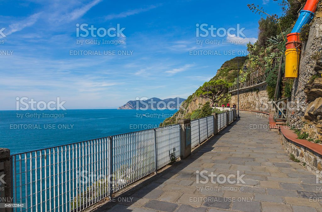 View along walkway in Riomaggiore, Italy stock photo