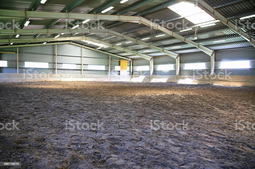 View an indoor riding arena backlight stock photo
