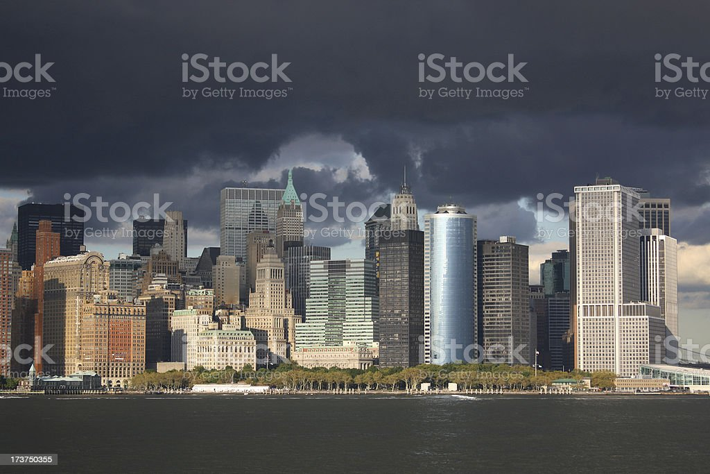 View at downtown Manhattan from the water with thunderstorm royalty-free stock photo