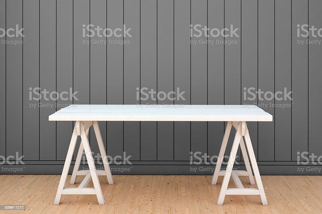 View at empty table surrounded by the gray wall stock photo