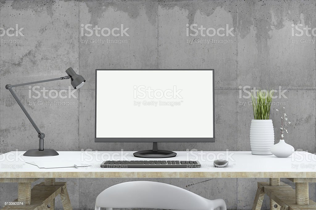 view at PC monitor in front of concrete wall stock photo