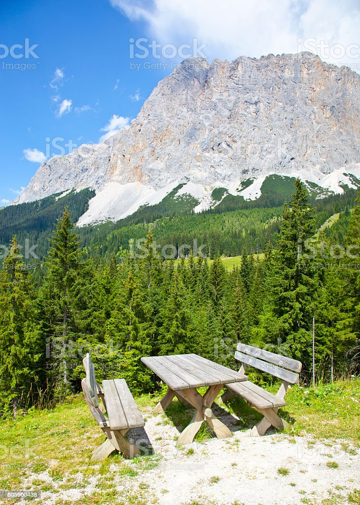 View at picknick table near Ehrwalder Almsee with mountain landscape stock photo