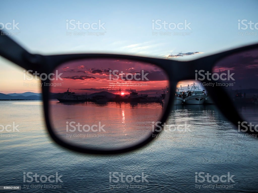View at sunset through glasses stock photo