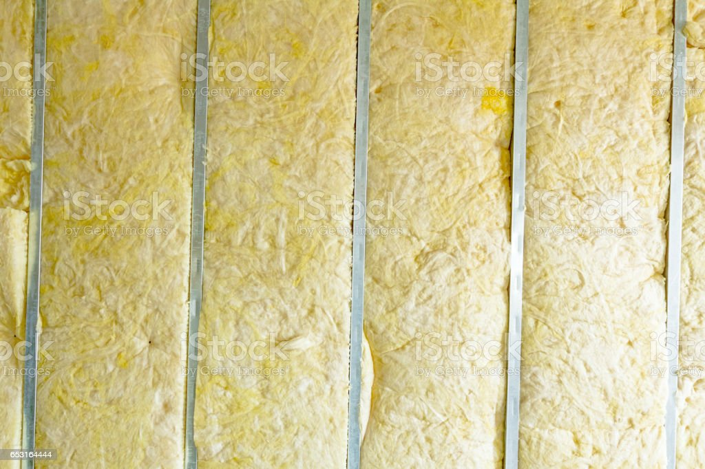 View at thermal party wall, heat isolation with mineral wool. stock photo