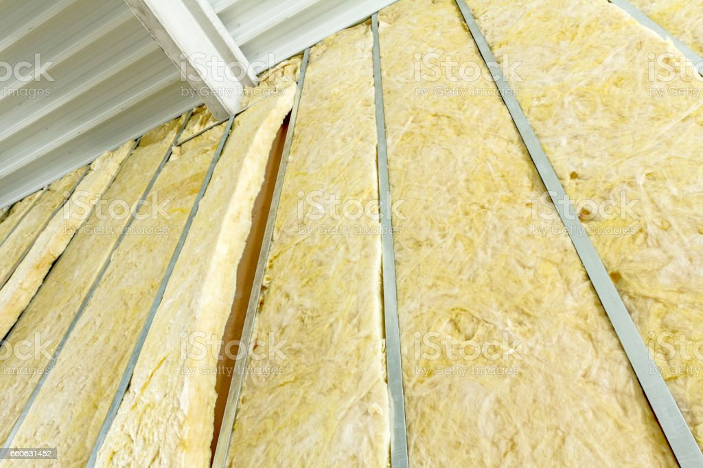 View at unfinished thermal party wall, heat isolation with mineral wool stock photo