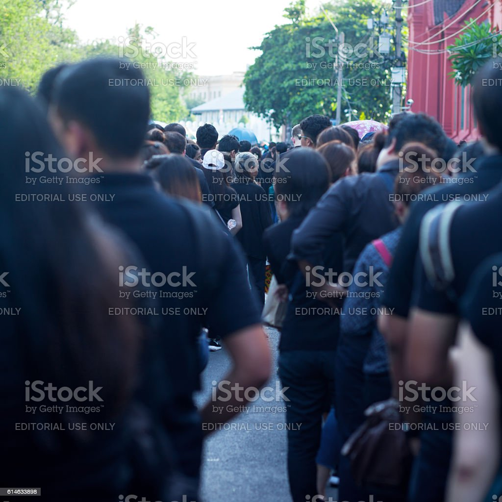 View between rows of thai people at condolence ceremomy stock photo