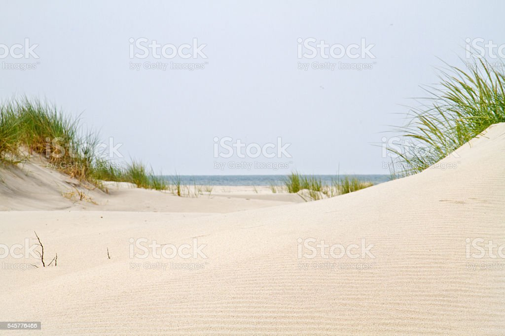 View between two dunes on the sea stock photo