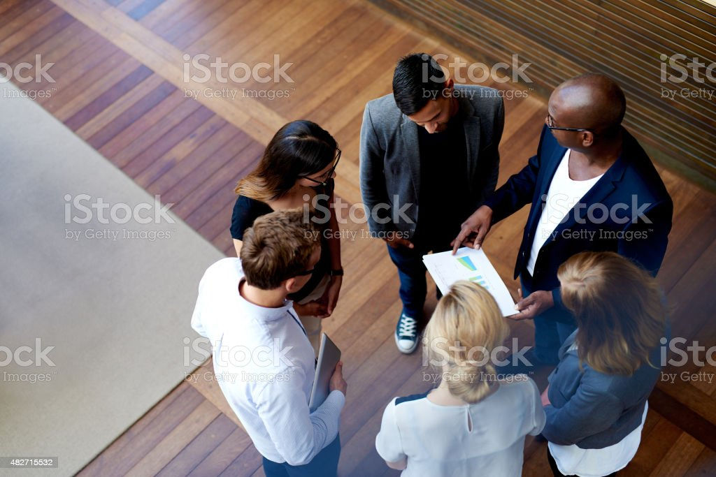 View down of colleagues gathered stock photo