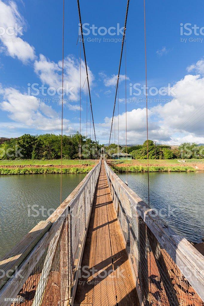 View down the famous swinging bridge in Hanapepe Kauai stock photo