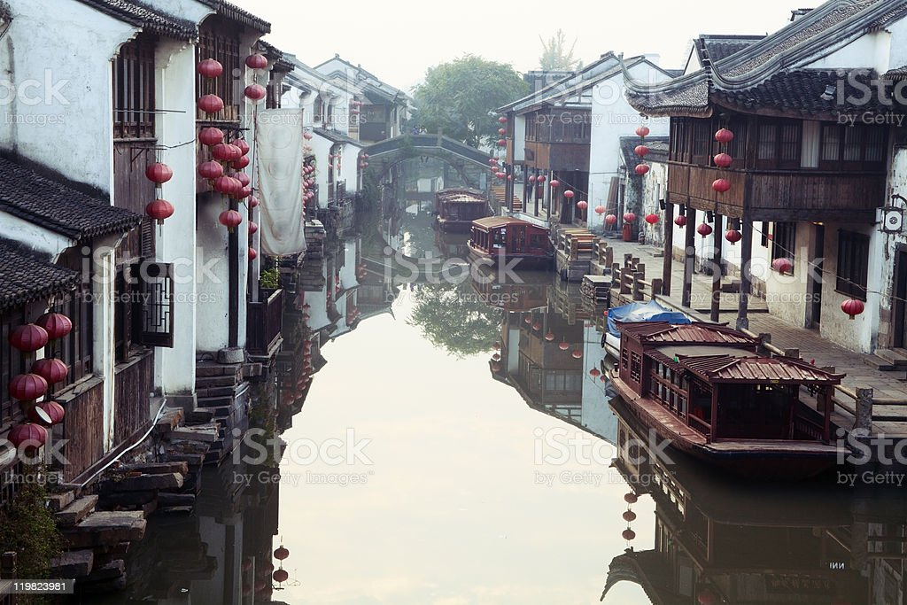 View down the Suzhou Canal with small boats floating stock photo