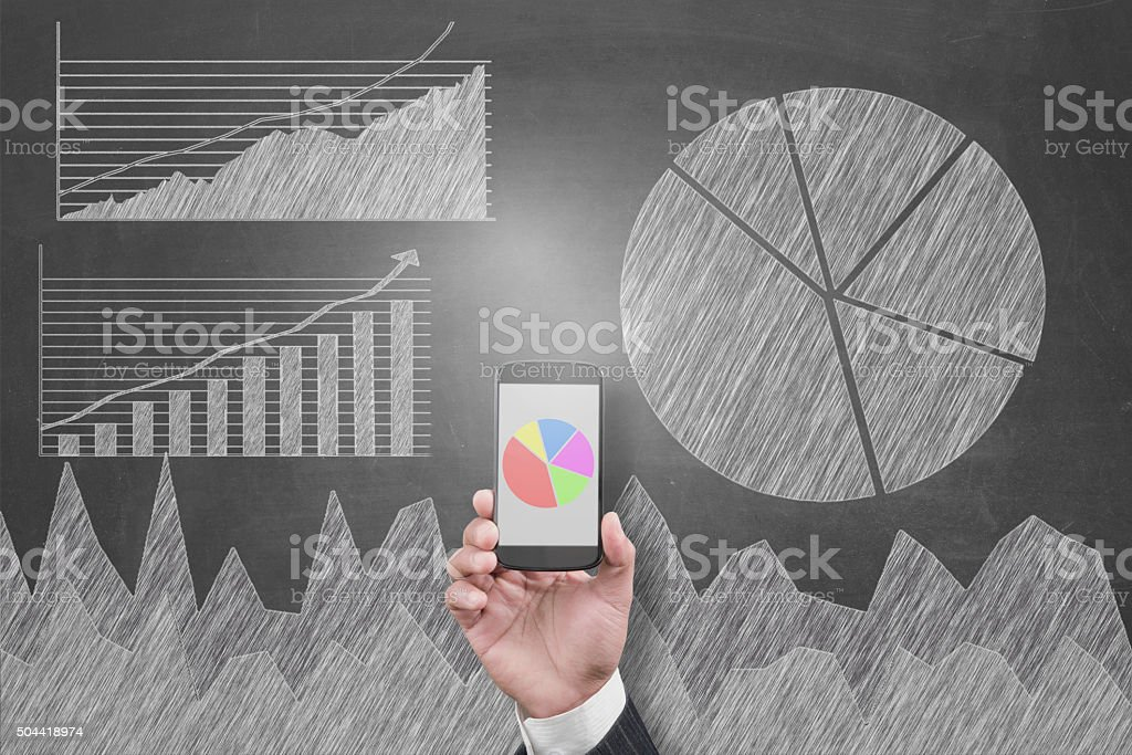 View financial data online on mobile phone stock photo