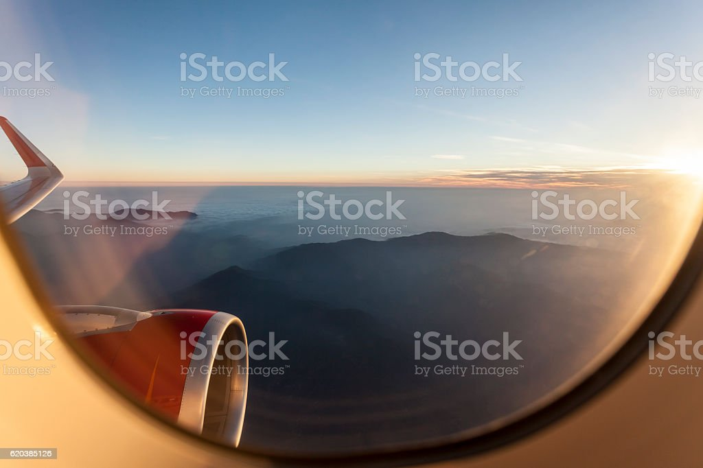 View for Himalayas   from the porthole on airplane. stock photo