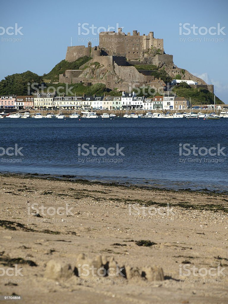 View from a beach at Gorey Castle in Jersey stock photo