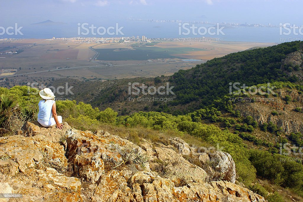 View from a mountain over the sea, after climb. stock photo