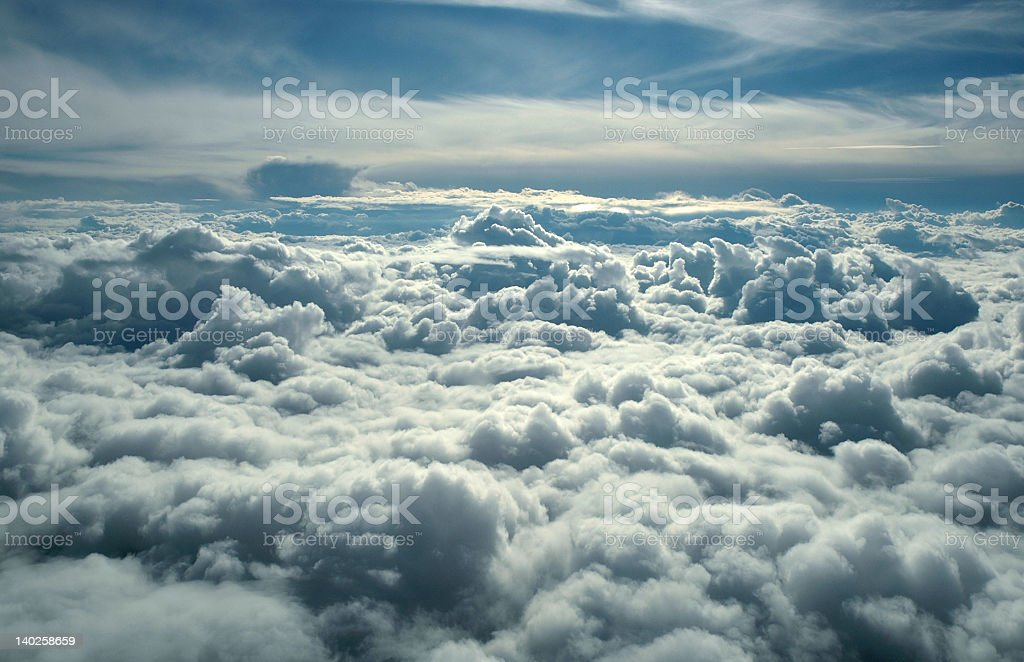 View from a plane flying above cloud level stock photo