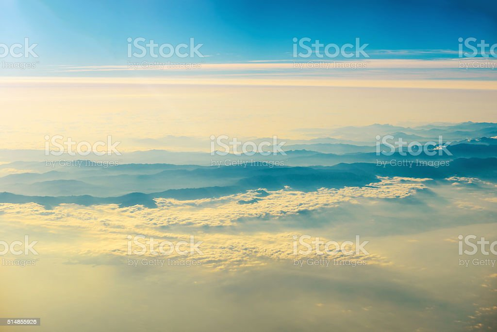 View from a plane to sunset on the sky stock photo