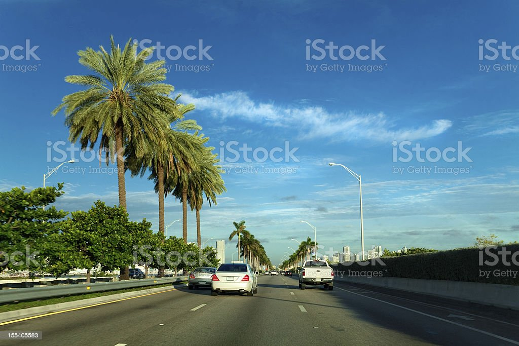View from a vehicle travelling on a highway in Miami stock photo