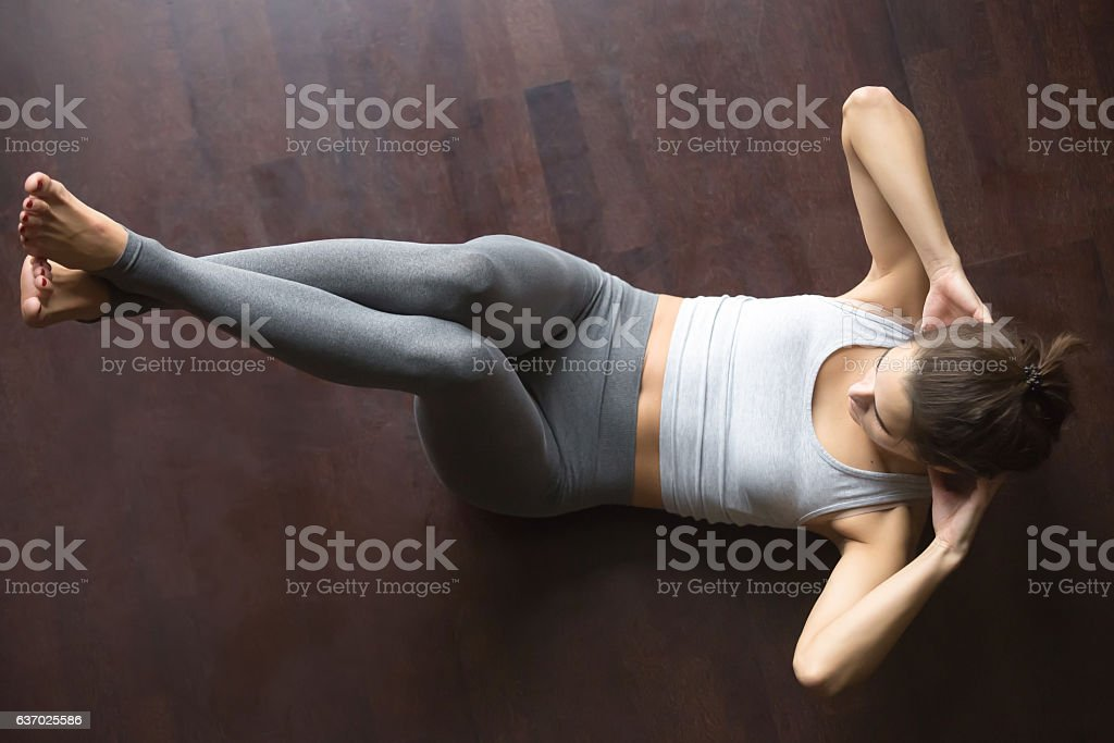 View from above. Abdominal crunches stock photo