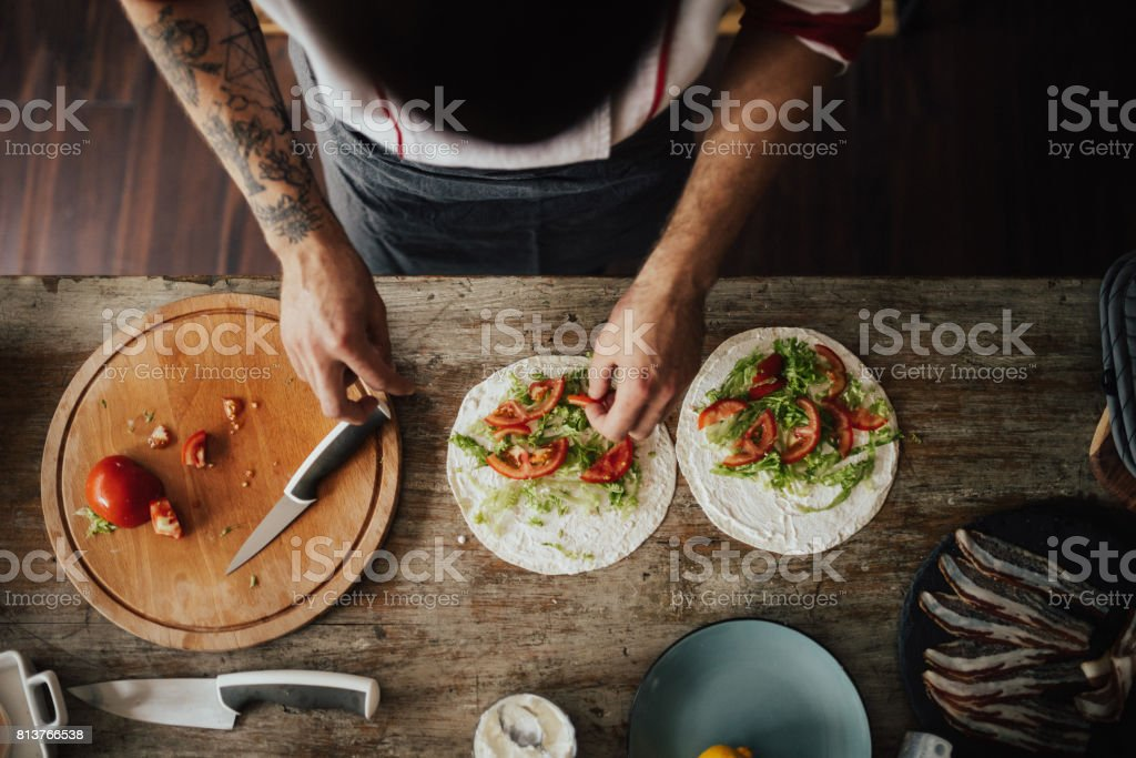 View from above at chef making veggie wraps stock photo
