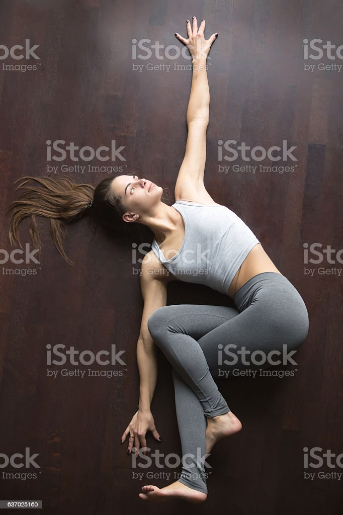 View from above. Belly Twist Pose stock photo